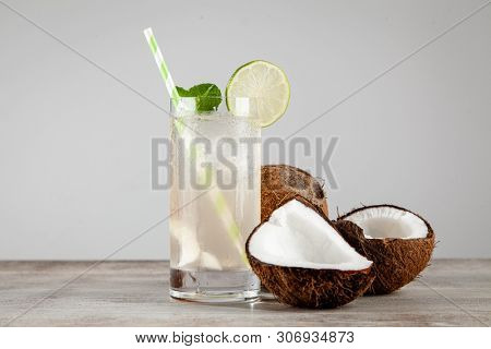 Coconut water drink on wooden background