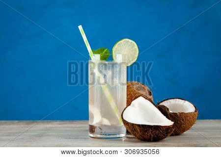 Coconut water drink on blue background