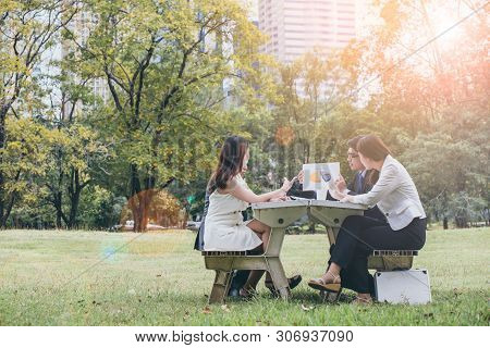 Man Making A Business Presentation To A Group In Garden.