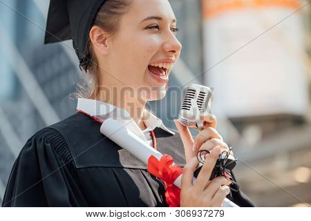Happy Woman On Her Graduation Day University. Education And People.happy To Announce The Release Of