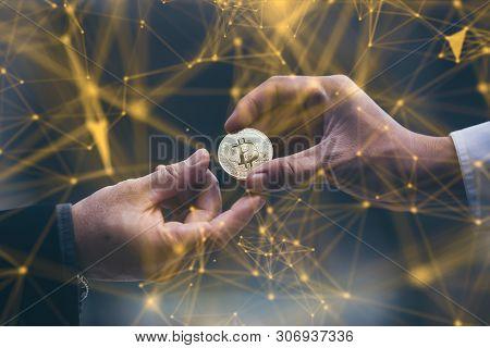 Businessman Gives The Bitcoin Man.selective Focus.block Chain Technology Concept.war Of Bitcoin,digi