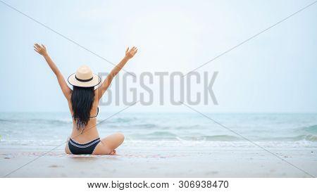 Sexy Bikini Body Asian Woman Playful On Paradise Tropical Beach Having Fun Playing Splashing Water.