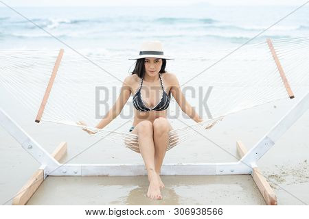 Relaxation Beach And Lazy Time Concept, Happy Asian Woman With Black And White Bikini.beautiful Asia