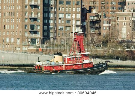 NEW YORK - FEBRUARY 19: Tugboat Evening Tide moves along the East River on February 19, 2005 near New York City. The tugboat was built in 1970 and is a twin screw tug rated at 3,900 horsepower.