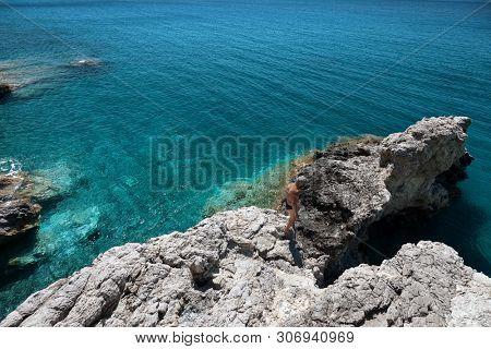Man walking on the rock. Tourism, travel concepts. Kythira island, Greece.