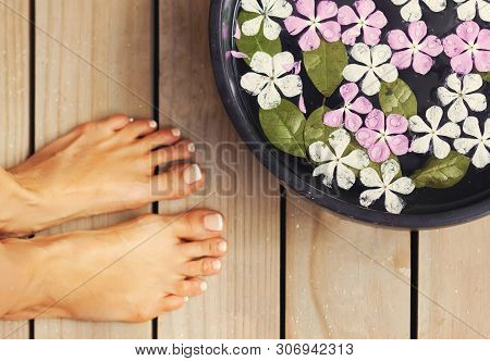 Spa Treatment And Product For Woman Feet And Foot Spa. Foot Bath In Bowl With Tropical Flowers, Thai