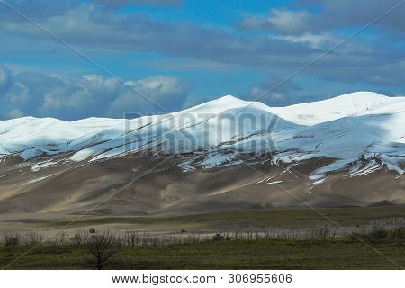 Dune Field In September Snow In Great Sand Dunes National Park In Colorado, United States