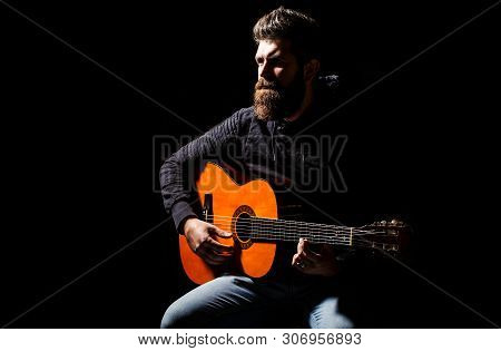 Bearded Guitarist Plays. Play The Guitar. Beard Hipster Man Sitting In A Pub. Live Music. Guitars An
