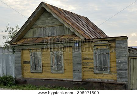 Boarded Up Windows On The Old Wooden Wall Of The House. Carving Adorns The Old Window. The Walls Of
