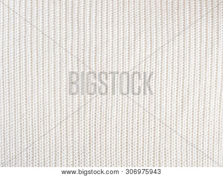 Knitted Loops Background. Part Knitted Sweater. Knitted Texture. White Knitted Fabric Texture. White
