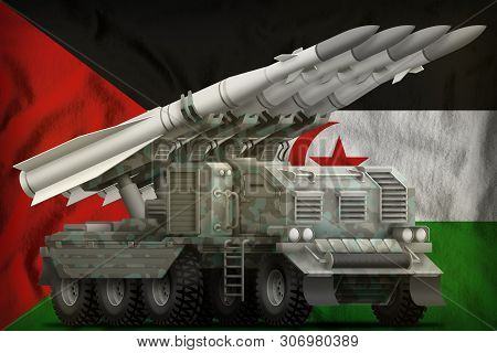 Tactical Short Range Ballistic Missile With Arctic Camouflage On The Western Sahara Flag Background.
