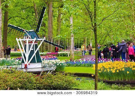 Keukenhof, Lisse, Netherlands - Apr 28th 2019: Famous Keukenhof Gardens With Windmill, Colorful Tuli