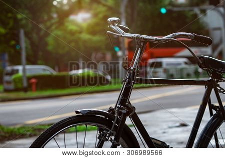 Bicycle Parked Near Street For Rent. Bike Tour In Singapore City. Eco-friendly Transport And Healthy