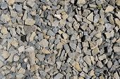 The texture of stone gravel gray. Stone rubble gray poured pile close-up. Stone path with grass. Similar Content poster