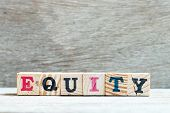 Letter block in word equity on wood background poster