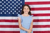 Free born and free bred. Carefree small child enjoying happy childhood. Happy little girl smiling on american flag decor. Free development. Free expression of the will. poster
