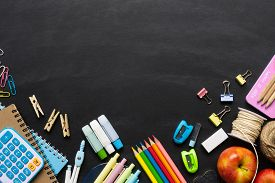 Back To School Background Concept. School Supplies On A Chalkboard Background. Education Background