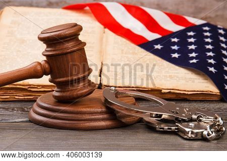 Wooden Gavel And Handcuffts. Guilty Sentence In American Court Concept.
