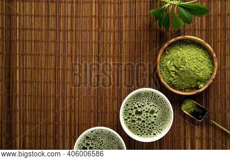 Matcha Tea Powder And Tea Accessories On Bamboo Napkin Background. Tea Ceremony. Healthy Drink. Trad