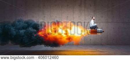 man sitting on a rocket with flames and smoke. concept of success and determination.