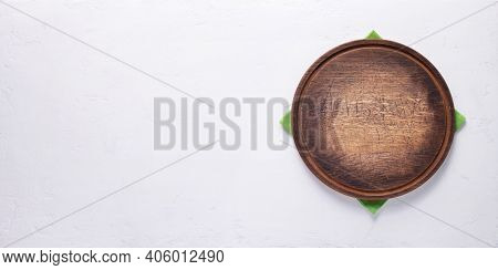 Pizza or bread cutting board for homemade baking on table. Food recipe concept at stone background texture with copy space. Flat lay of panorama, panoramic top view