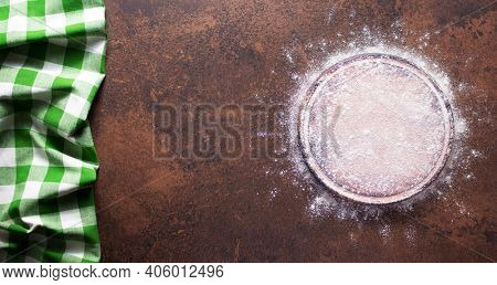 Flour food and pizza cutting board as bakery concept for homemade bread baking on table. Recipe  as panoramic top view at stone background texture with copy space, flat lay concept
