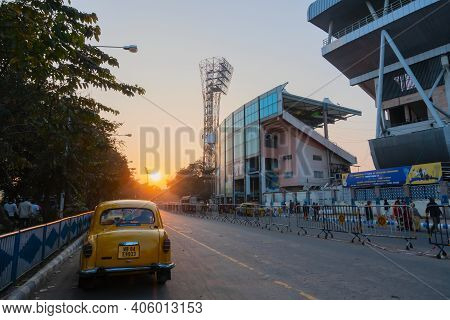 Kolkata, West Bengal, India - 12th January 2020 : Yellow Taxi Passing The Eden Gradens, Office Of Th