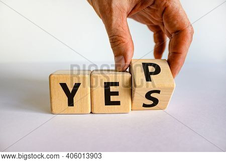 Yes Or Yep Symbol. Businessman Turns A Cube, Changes The Word 'yes' To 'yep'. Beautiful White Backgr