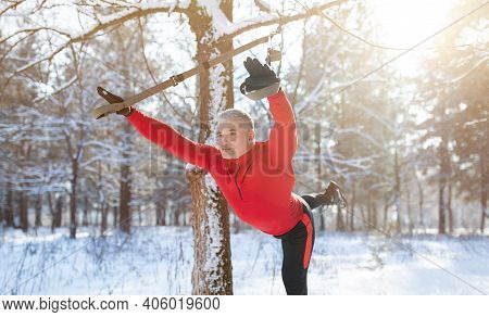 Senior Athletic Man In Sportswear Doing Exercises With Trx Fitness Straps Outdoors On Snowy Winter D