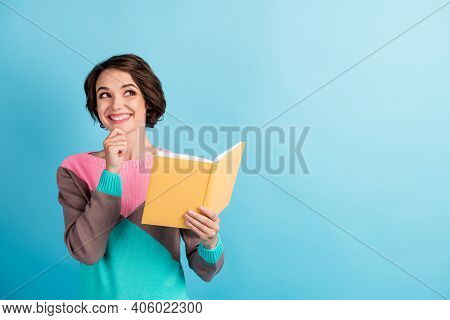Photo Portrait Of Smiling Dreamy Girl Looking Up At Blank Space Smiling Holding Book Touching Face I