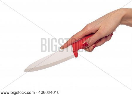 Kitchen Knife In A Female Hand Isolated On A White Background.