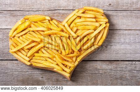 Love French Fries With Rosemary And Ketchup . Fastfood Background Heart