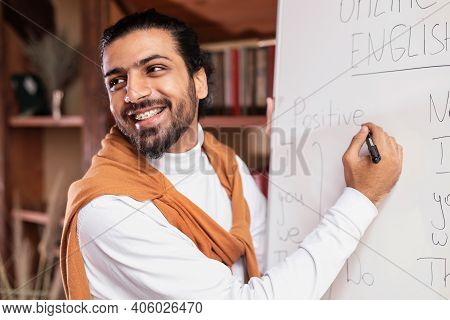 Portrait Of Young English Teacher Writing Language Grammar Rules Teaching Students Online Standing N