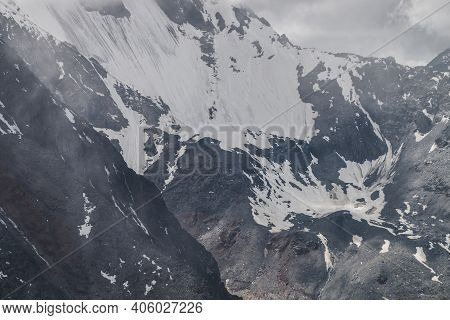 Atmospheric Minimalist Textured Alpine Landscape With Massive Hanging Glacier On Big Mountain In Low