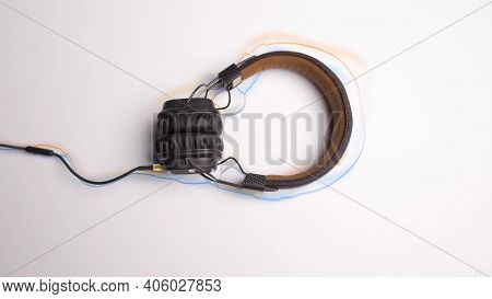 Headphones On White Background With Animated Lines. Animation. Headphones Frame Moving Colored Lines
