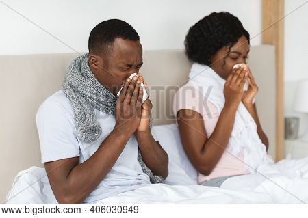 Sick African American Man And Woman Got Coronavirus Or Cold, Sneezing Their Noses, Staying In Bed Du