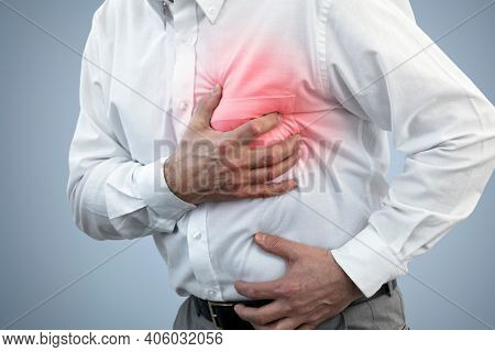 Businessman with chest pain holding his chest concept for heart attack, stoke or asthmatic