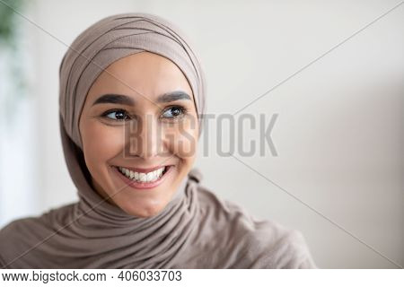 Closeup Portrait Of Cheerful Muslim Lady In Stylish Headscarf Looking At Copy Space, Panorama. Happy