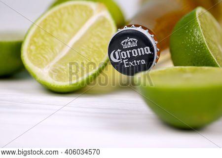 Kharkov, Ukraine - December 9, 2020: Bottle Of Corona Extra Beer With Lime Slices. Corona Produced B