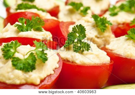 filled tomato appetizer on a plate