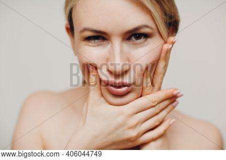 Young Adult Doing Facial Gymnastics Self Massage And Rejuvenating Exercises Face Building For Skin A