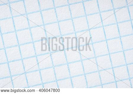 Background Of Squared Notebook Sheet Or Grid Paper. Light White Backdrop. Rough Textured Surface Wit