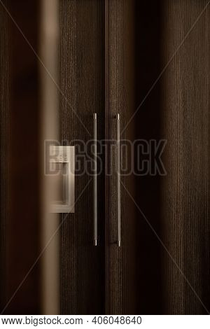 The Doors Of An In-built Fridge In The Modern Kitchen. A Modern Built-in Fridge With Decorative Wood