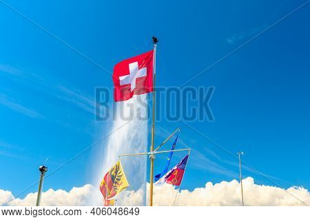 Swiss Flag, European Flag And Canton Of Geneva Flag And On Background The Most Famous Attraction And