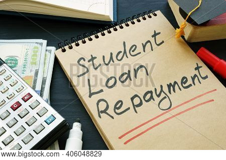 Student Loan Repayment Sign, Notepads, Calculator And Cash.