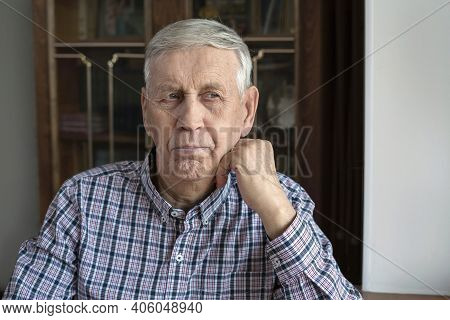 Portrait Of A Serious, Pensive Old Man, 80 Years Old.