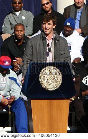 NEW YORK - FEB 7, 2012: New York Giants quarterback Eli Manning (10) speaks during the Super Bowl XLVI victory celebration at City Hall in downtown Manhattan.