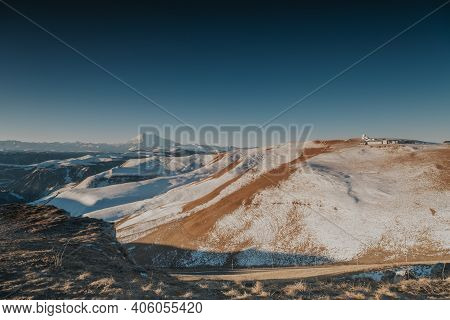 Snowy Mountains Of Elbrus In Winter. Vacation In The Mountains.
