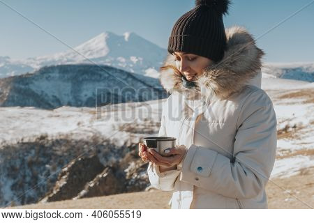 Tea Drinking In The Mountains. Traveler With A Mug Of Hot Drink In The Mountains.