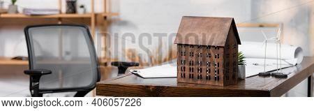 House Model Near Wind Turbines Maquettes On Desk In Architectural Bureau, Banner